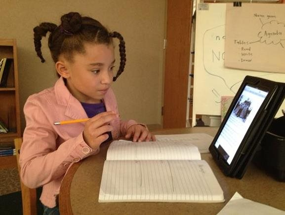 Student working on homework on an ipad